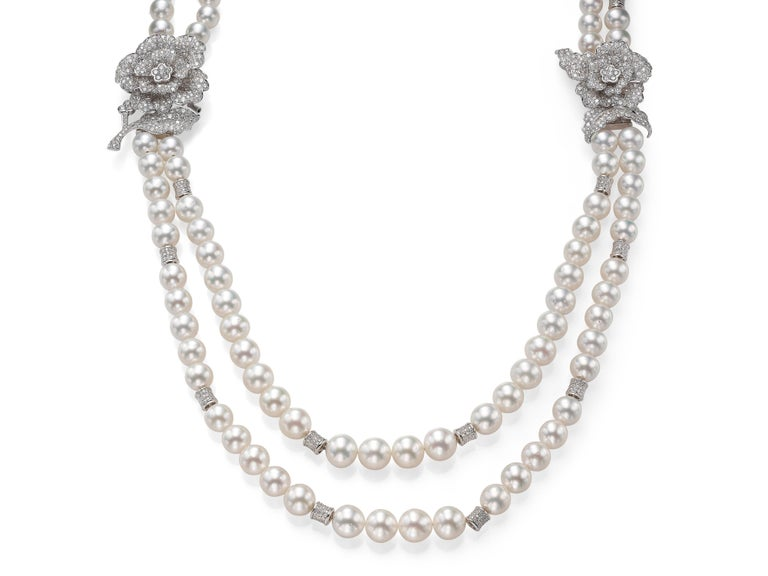 This marvelous Butani necklace exudes opulence and elegance.  Made from two strands of beautiful white South Sea Pearls (graduating from 9-13mm) and accented with two diamond floral pieces that can be detached and worn separately as brooches