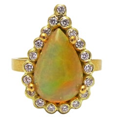 2.6 Carat Pear Shaped Ethiopian Opal Handmade Gold Diamond Halo Ring