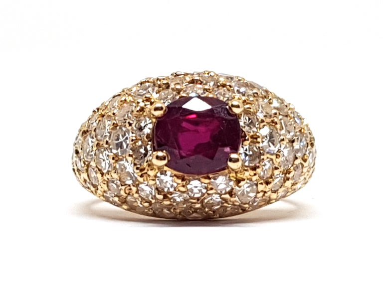 Gold: 18 Karat Yellow Gold  Weight: 5.20gr.  Diamonds: 1.60 ct. Colour: F clarity: VS1  Ruby: 1.00ct.  Width: 1.60 cm.  Ring size: 52 / 16.75mm  Free resizing of Ring up to size 60 / 19mm / US 9  All our jewellery comes with a certificate and 5