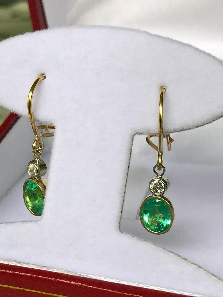 2.60 Carat Natural Colombian Emerald Diamond Dangle Earrings 18K Gold Primary Stones: 100% Natural Colombian emeralds Shape or Cut Emerald : Oval Cut  Average Color/Clarity : Beautiful Medium 100% NATURAL Green Color/ Clarity VS  Total Weight
