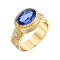 2.60 Carat Oval Tanzanite, Diamond Yellow Gold Engraved Bezel Band Ring