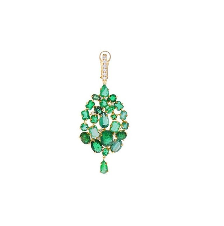 These show-stopping chandelier earrings are dripping with luxury featuring 48 mixed-cut emeralds in a lavish cluster setting totaling 26.00 carats of pure vibrant green. The gem source is Zambia. These vibrant green emeralds are complemented by