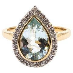 2.62 Carat Pear Cut Aquamarine and Diamond Halo Cluster 9 Carat Yellow Gold Ring