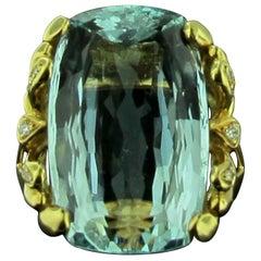 26.24 Aquamarine Set in 18 Karat Yellow Gold with Diamonds