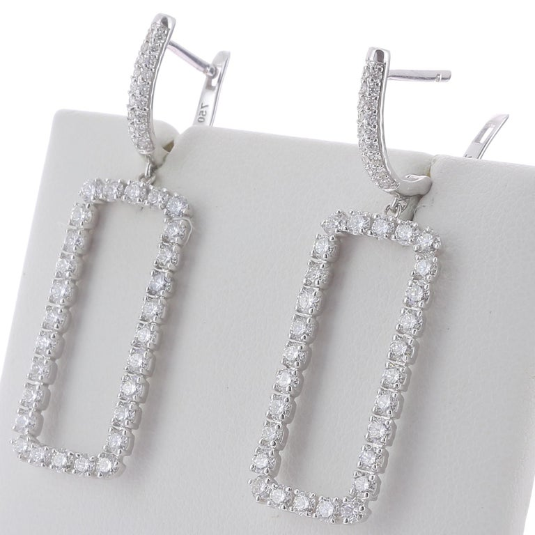 The Rectangle Diamonds Earrings are set with Round Diamonds weighing 2.63 Carat. The Earrings are set with 56 Round Diamonds with a rectangle pattern weighing 2.42 Carats, and a halo of round diamond weighing 0.21 Carat The Diamonds are GVS