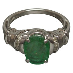 2.63 Carat Oval Emerald and Diamond 10 Karat White Gold Ring