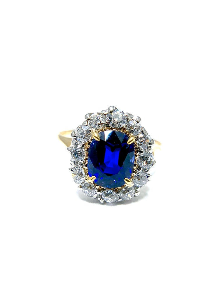 A stunning Egyptian blue oval Sapphire and Diamond ring!  The Sapphire is a natural no enhancement 2.63 carat beauty, surrounded by a single row of round brilliant Diamonds totaling 1.00 carat.  The Diamonds are set in platinum, with the sapphire