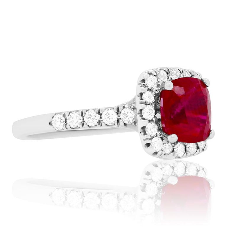 Material: 14K White Gold Gemstone Details: 1 Cushion Ruby at 2.63 Carats  Diamond Details: 26 Brilliant Round White Diamonds at 0.55 Carats. SI Clarity / H-I Color.  Ring Size: 6.5. Alberto offers complimentary sizing on all rings.  Fine one-of-a
