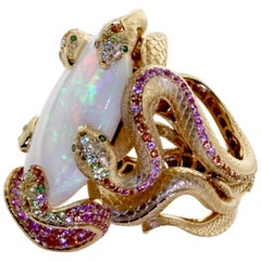 26.33 Carat Opal, 18 Karat Yellow Gold Snake Ring