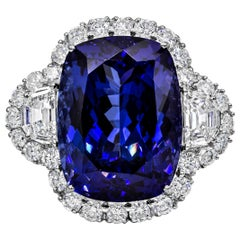 26.35 Carat Cushion Cut Tanzanite and Diamond Three-Stone Halo Ring