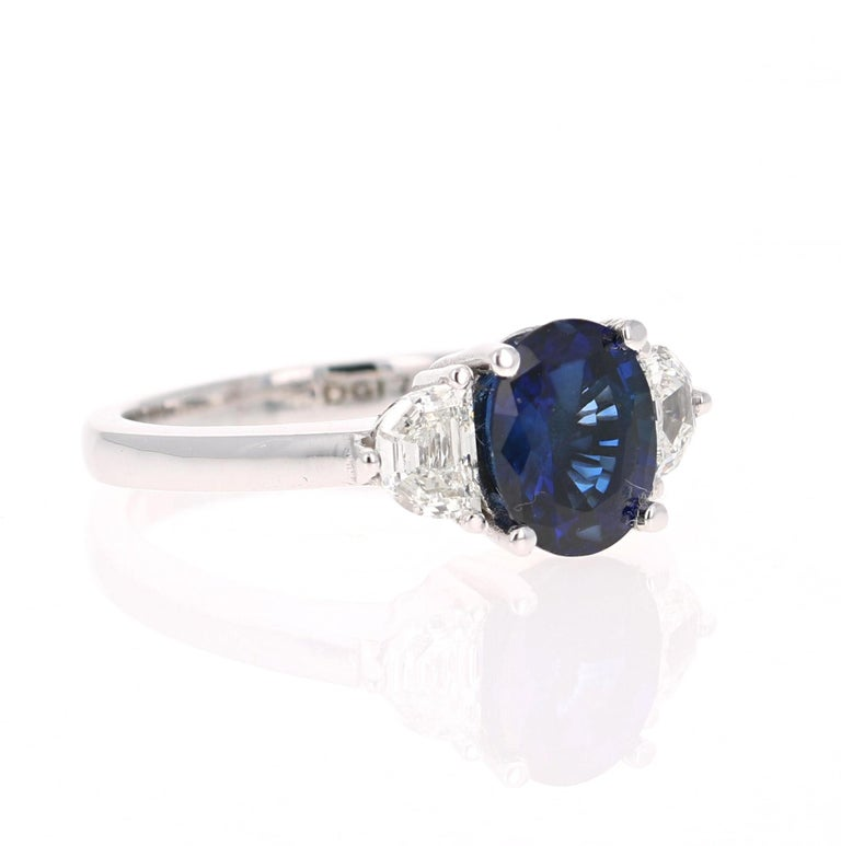 Beautiful Sapphire Diamond Three-Stone Ring - representing Past, Present and Future  This ring has a Blue Sapphire that weighs 2.00 Carats and is GIA Certified. The Sapphire is a natural Blue Oval Cut with Heat. The GIA Certificate Number is: