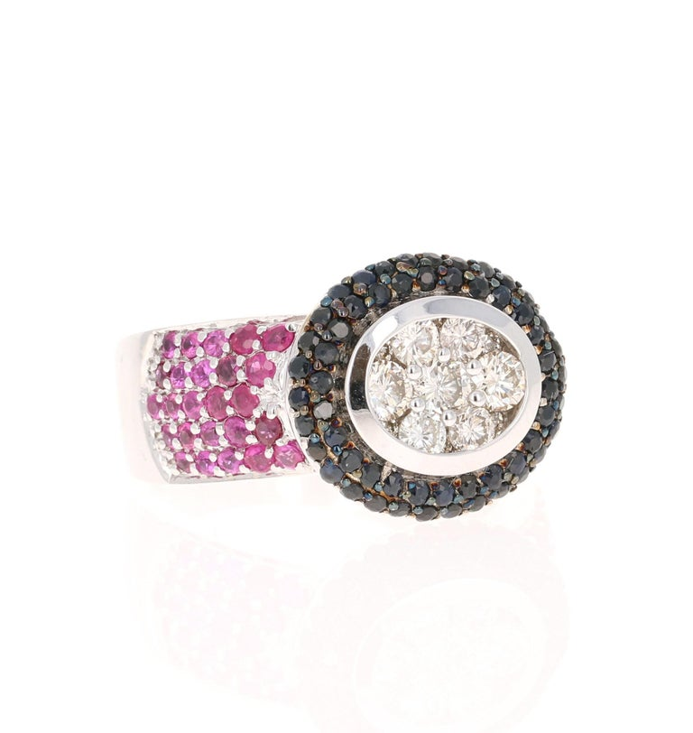 This ring has 7 Round Cut Diamonds that weigh 0.65 Carats (Clarity: VS, Color: H) and 60 Black Diamonds that weigh 0.85 Carats. Furthermore there are 50 Pink Sapphires that weigh 1.15 Carats. The total carat weight of the ring is 2.65 Carats.   It