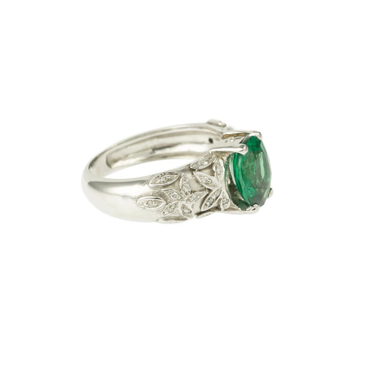 Beautiful and original ring set with a central 2.67 carats Tsavorite garnet on a setting with small diamonds on each sides. 18 Carats white gold, 750/1000th mounting. Eagle's head stamp  Tsavorite garnet: 2.67 carats Color: intense green Very
