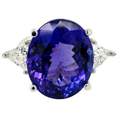 26.79 Carat Oval Tanzanite and Diamonds Ring 18 Karat