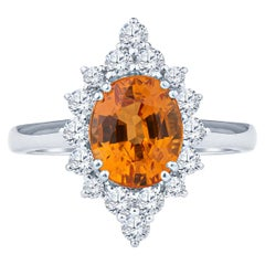 2.68 Carat Fine Orange Spessartine Oval Gem Quality Garnet and Diamond Halo Ring