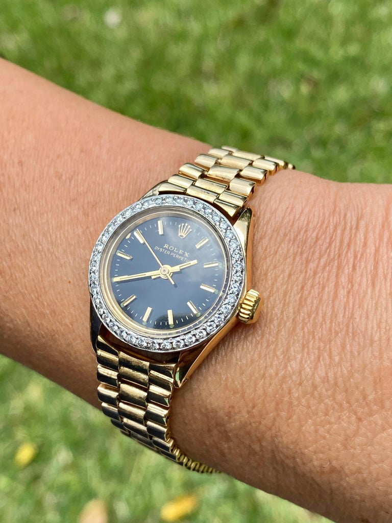 A Rolex Oyster Perpetual Watch Co. 18k gold wristwatch, rhodium-plated cal. 1400 movement with Jubilee bracelet, stick marker textured Black dial with stick hands. The bezel is adorned by 1.10 carats of natural round Diamonds.   Details: ✔ Watch