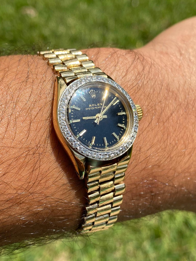 Men's Rolex Oyster Perpetual Black Face/Diamond Bezel Rolex in 18k Yellow Gold For Sale