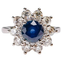 2.7 Carat Round Blue Sapphire 1.9 Carat Diamond 14 Karat Gold Floral Halo Ring