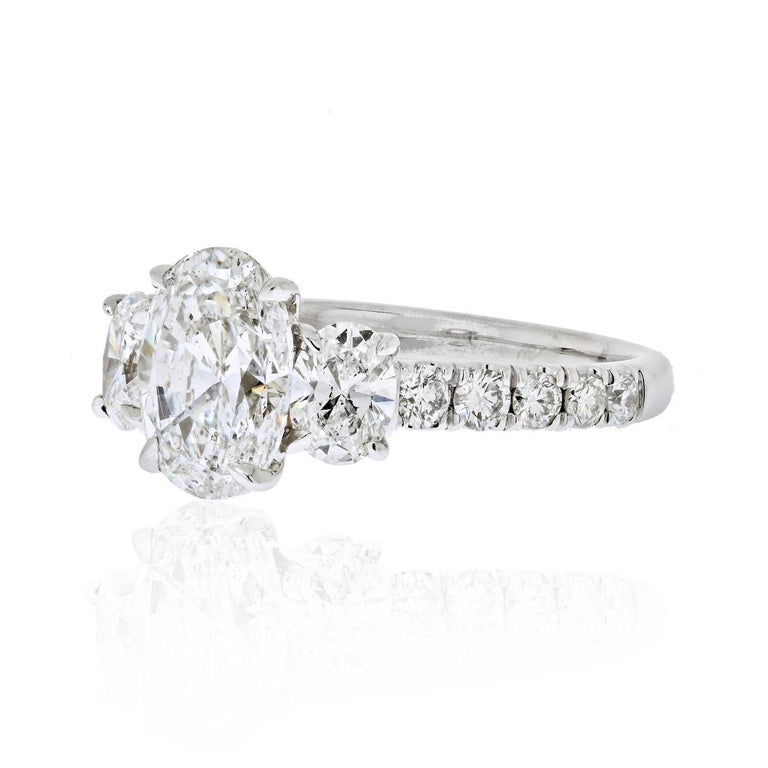 When you are after a classic three stone ring but want that extra finger coverage and sparkle we think we have just the right ring for you!   It is mounted with three oval cut diamonds that are GIA certified D and E colors.   Center diamond is a