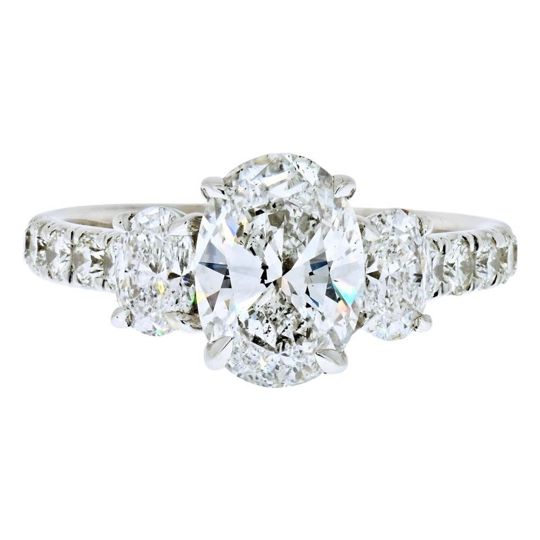 2.70 Carat Oval Cut Diamond Three-Stone Engagement Ring For Sale