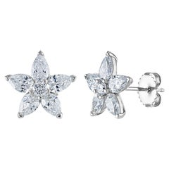 2.70 Carat Star Diamond Gold Stud Earrings