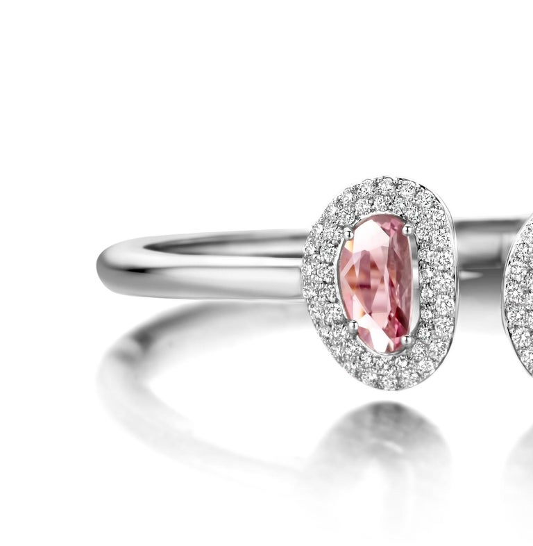 """One of a kind two-stone """"Didi"""" bangle in 18K white gold 18,5g set with the finest diamonds in brilliant cut 0,71Ct (VS/F quality), a natural pink sapphire 0,94Ct and a natural yellow sapphire 1,79Ct in double rose cut.   Because every sapphire has"""