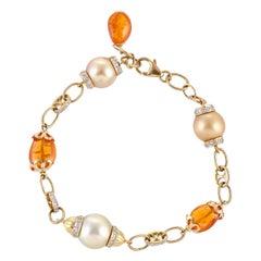 27.37 South Sea Pearl Mandarin Garnet Diamond 18 Karat Yellow Gold Bracelet
