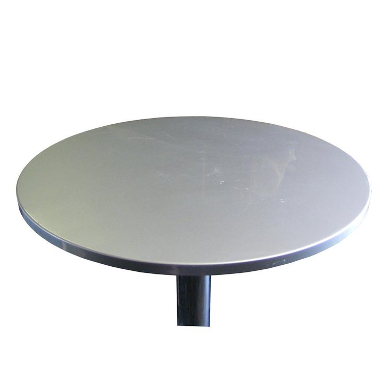 Ligne Roset     Michael Köenig    A Ligne Roset Bobine height adjustable table by Michael Köenig. Chrome-plated constructed base with a steel top. The height of the table may be adjusted by means of a gas piston. Adjustable from 29