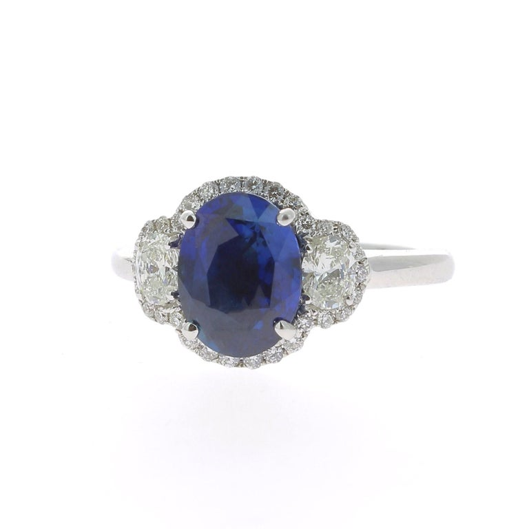 Oval Cut 2.77 Carat Blue Sapphire Cocktail Ring Set with Oval and Round White Diamond 18K For Sale