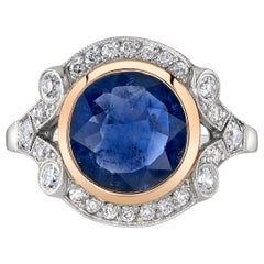 2.77 Carat Round Cut Blue Sapphire Set in an 18 Karat Gold and Platinum Ring