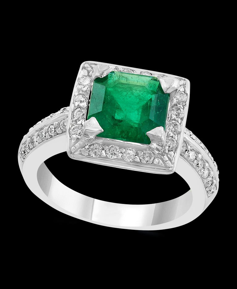A classic, Cocktail ring  2.8 Carat  Colombian Emerald and Diamond Ring, Estate, no color enhancement. Gold: 14 carat white gold  Weight: 7.5 gm  Diamonds: approximate 0.85 Carat  Emerald: 2.8 Carat  Origin : Colombia  Color: Deep  Green,