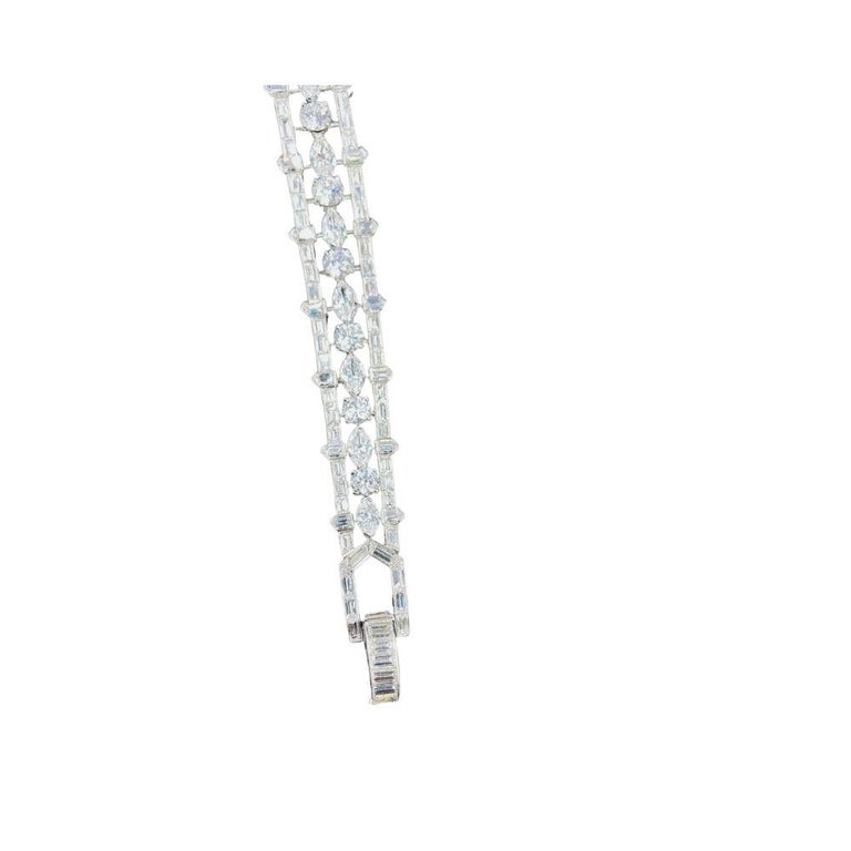 Multi Shaped Diamond Bracelet By Van Cleef and Arpels $120,000.00Price Rare Van Cleef and Arpel diamond bracelet 28 carats of marquise, round and baguette diamonds, made in platinum. Diamond Details Shape Round, Marquise and Baguettes  Color E-F