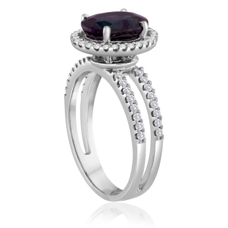 Sapphire Stone in Halo with Double Diamond Bands Ring The ring is 18K White Gold Ring There are 0.50 ct of Diamonds F/G VS/SI The Center stone is 2.82 Carat Oval Blue Sapphire The ring is a size 6.00, sizable. The ring weighs 4.7 grams