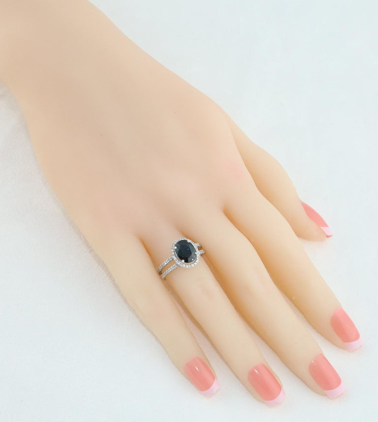 Contemporary 2.82 Carat Oval Blue Sapphire Diamond Gold Ring For Sale
