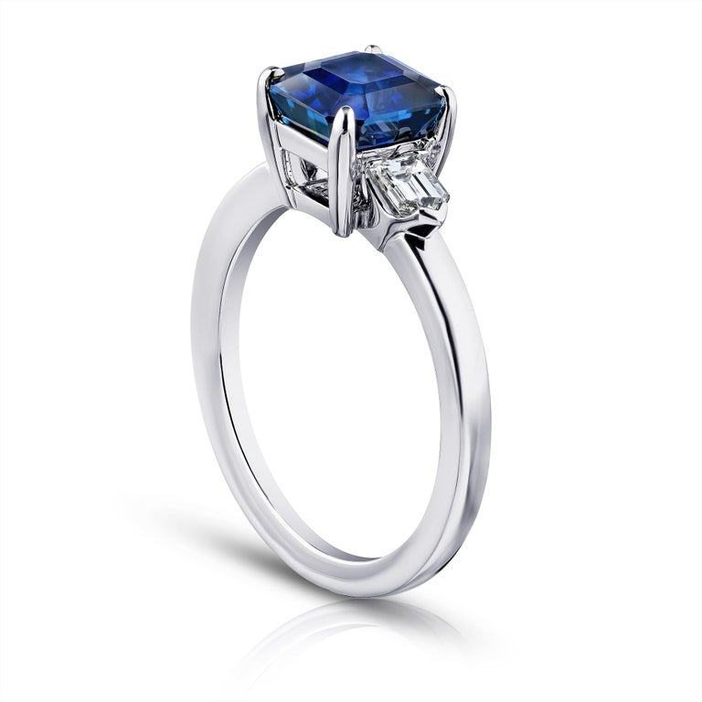 2.83 carat emerald cut blue sapphire with bullet shape diamonds .41 carats set in a platinum ring.