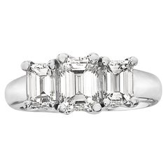2.84 Carat Trilogy Platinum Emerald Cut Engagement Ring