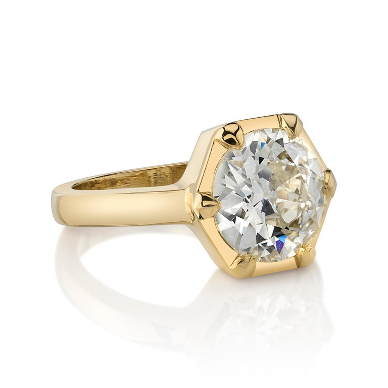 2.85ctw O-P/VS1 GIA certified old European cut diamond set in a handcrafted 18K yellow gold mounting.  Ring is a size 6 and can be sized to fit.