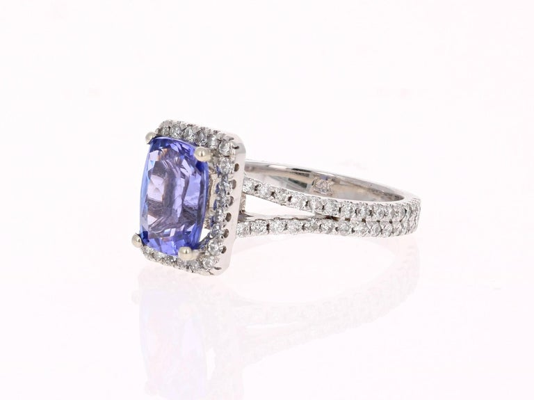 This Gorgeous Ring has a 2.06 Carat Tanzanite that is set in the center of the ring.  The Tanzanite is surrounded by a Halo of 93 Round Cut Diamonds that weigh 0.79 carats. The total carat weight of the ring is 2.85 carats.     The ring is made in
