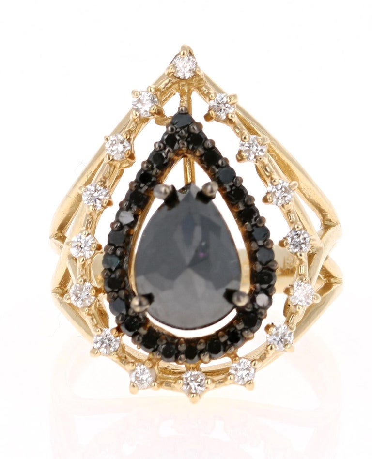 2.86 Carat Pear Cut Black Diamond Yellow Gold Cocktail Ring!  Stunning Victorian Inspired Cocktail Ring. There is a 2.19 Carat Pear Cut Black Diamond set in the center of the ring. The Pear Cut Black Diamond is surrounded by 26 Round Cut Black