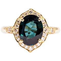 2.87 Carat Oval Cut Teal Sapphire and 0.30 Carats Diamond 18 Carat Gold Ring