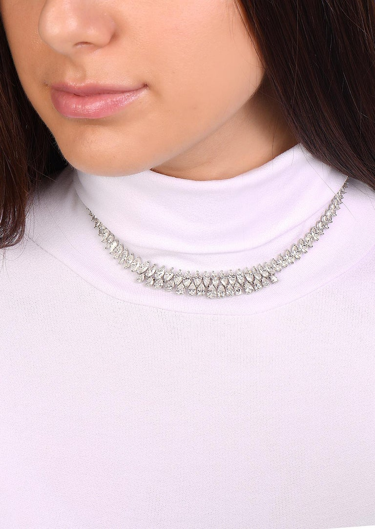 This necklace features 28.72 carats of G-H VS diamonds 15 pears and 20 marquise diamonds set in 18K white gold. This vintage necklace was made in Italy with the highest quality standards of craftsmanship. It has a comfort fit and molds to the curves