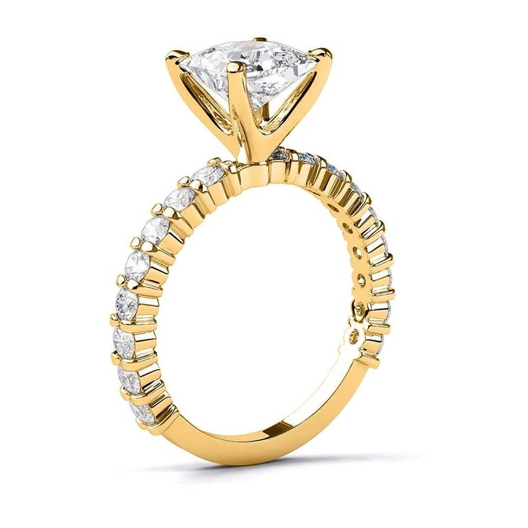Amazing solitaire with accents 4-prong diamond engagement ring. Center stone is natural, princess, F-G color, VS2-SI1 clarity, diamond is clarity enhanced 2 carat diamond and it is surrounded with 18 natural diamonds.    Currently a US ring size 6