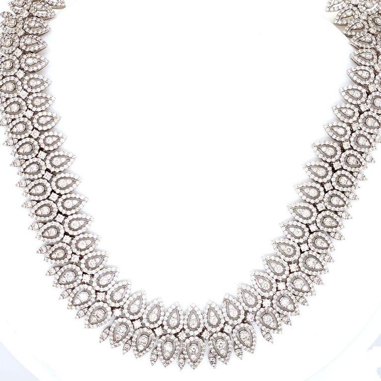 Stunning statement diamond necklace hand crafted in 18 karat white gold. This fabulous necklace features round brilliant cut white diamonds set in a marquise fashion. The diamonds weigh approximately 29 carats and are graded H-I color and