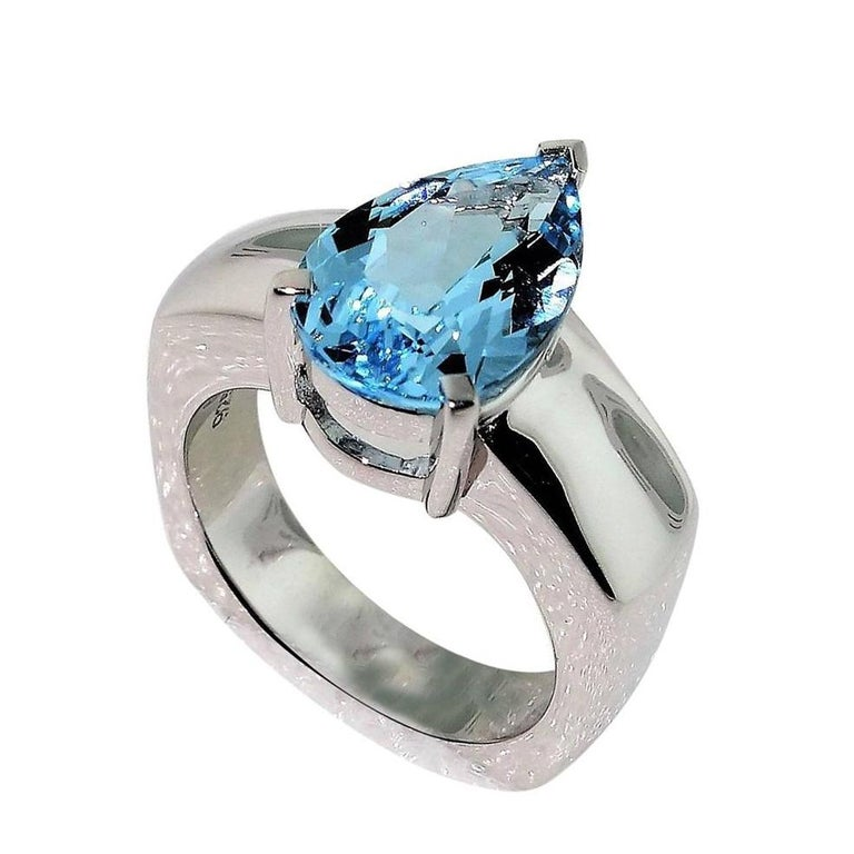 Beautiful ring featuring a 2.90ct Blue Topaz in center enhanced with Diamonds; approx. .06tctw; Sterling Silver Tarnish-resistant Rhodium mounting. Size 7. Stylish and Classy…illuminating your look with Timeless Beauty!