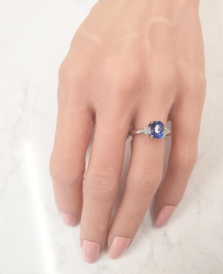 Vibrant pops of color and scintillation are on full display with this breathtaking custom made 18 karat white gold cocktail ring. A fine quality cushion-cut sapphire is secured in a four prong setting with a weight of 2.90 carats, displaying a fine