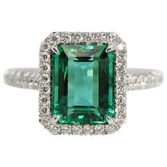 2.91 Carat Emerald Cut Green Emerald and Diamond Ring