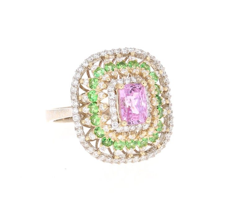 Beautiful and Unique Pink Sapphire, Tsavorite, & Diamond Ring!!   This ring has a Emerald Cut Pink Sapphire that weighs 1.49 Carats. The Pink Sapphire has a GIA Certificate: #1192204377. The ring is embellished with 112 Round Cut Diamonds that weigh