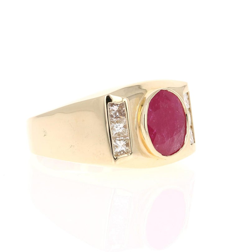 We also carry a unique Men's Collection of Wedding Bands & Rings!   This amazing piece is set with a beautiful oval cut Ruby that weighs 2.23 Carats and has 6 Princess Cut Diamonds that weighs 0.70 Carats. The Total Carat Weight of the ring is 2.93