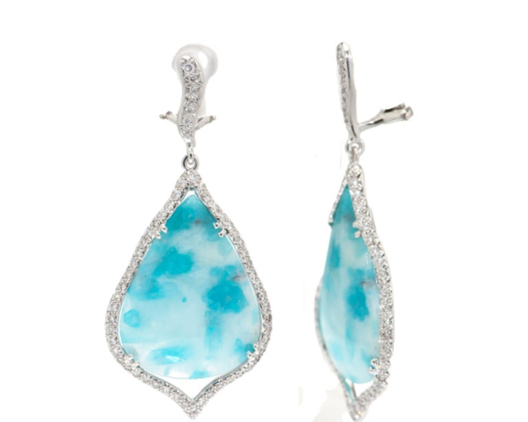 Beautiful pair of Chandelier Dangle Earrings set with Tear Drop Paraiba Tourmaline Gemstones from Brazil; measuring approx. 33.14 x 21.04mm and 26.63 x 19.74mm, surrounded by round brilliant cut diamonds. Hand crafted in 18K white Gold. Classic and