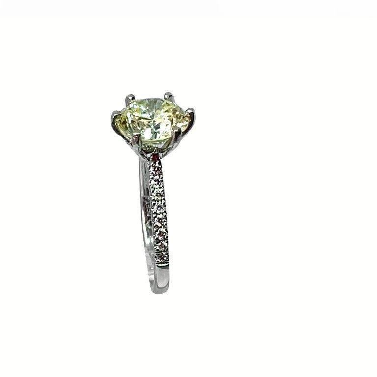 Modern 2.94ct certificated light yellow diamond set in platinum 6 claw mount and shank  For Sale